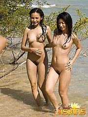 Asian cuties Asako and Mai touching their petite bodies on the beach